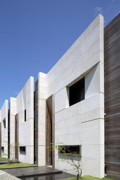 Image 12 of 22 from gallery of Green Collection / RT+Q Architects. Photograph by Albert Lim KS Arcade Architecture, Architecture Art Design, Brick Architecture, Minimalist Architecture, Facade Design, Residential Architecture, Contemporary Architecture, Architecture Details, Stone Facade