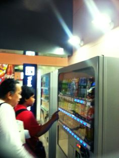 Eating out:  with William and Fidel getting food from a vending machine in OSAKA, JAPAN, 2013