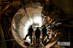 #urbex urban explorer at the entrance of an technical gallery