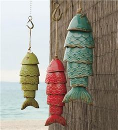 ♥ ♫ ♪ Colored porcelain Koi Fish wind chimes by windandweather. Nothing to wind in the wind but they make a lovely sounds by shaking their tails. ♫ ♪