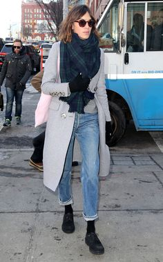 Alexa Chung was spotted wearing a light-wash pair of Levi's Vintage 501 Jeans, paired with a plaid scarf and heather grey coat.