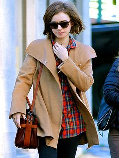 She may be trying to blend in with crowd, but Lily Collins stands out in shades while making her way around Beverly Hills on Thursday.