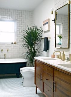 Loving the plants in the bathroom for a fresh and natural look!