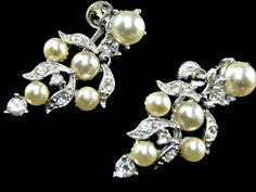 Vintage Bogoff Rhinestone and Pearl Earrings Signed Wedding Presented by EclecticVintager Approximate measurements: 1.50 inches by .75 inch These vintage Bogoff earrings have a dangle of luminescent faux pearl interspersed with rhinestone encrusted ribbons of  icing , accented by #PearlEarrings