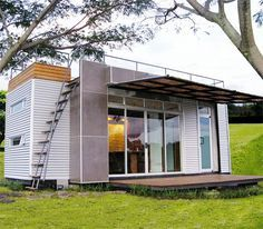 Tiny Glass-Walled Container Home Features Rooftop Deck <~ I am fascinated by the tiny house movement.