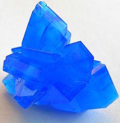 Chalcanthite (copper sulfate; CuSO4·5H2O).