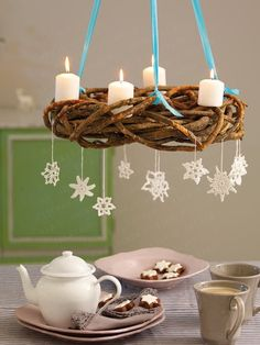 I like that this Advent Wreath hangs... I would do it with colored candles and with out the snowflakes.