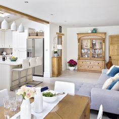 Open plan kitchen diner with grey chaise lounge sofa