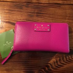 Kate Spade Wallet. Magenta/Hot Pink Perfect condition. Used a couple of times. A lot of room/pockets. Leather exterior. Cloth interior Accessories