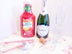 Pink Mimosas - one ice cube (heart shaped?), Tropicana Farm Stand Strawberry Banana juice, and champagne!
