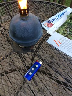 Ever look for a fire starter?  Glued a magnet on a lighter with silicone and attached to (under top) metal patio table!