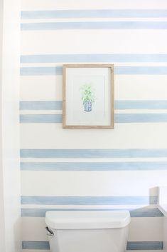Striped Walls with Washed Out Blue Stripes If you're looking for a fresh and easy alternative to standard striped walls, take a look at this washed out stripes bathroom accent wall. Bathroom Accent Wall, Bathroom Accents, Bathroom Colors, Bathroom Ideas, Striped Bathroom Walls, Bathroom Designs, Bathroom Fixtures, Striped Accent Walls, Paint Accent Walls