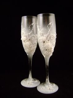 Hand decorated wedding champagne glasses, classic elegant toasting flutes in white. $54.00, via Etsy.