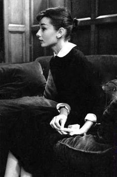 Audrey Hepburn photographed in the bar of Hôtel Raphael in Paris, c. 1956.