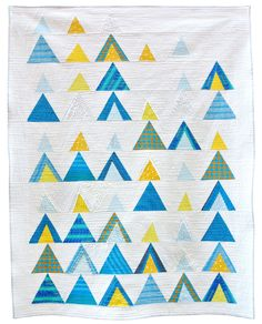 More triangles! I can't get enough lately. The blue and yellow color scheme feels fresh and light.    Mod-Mountains Quilt