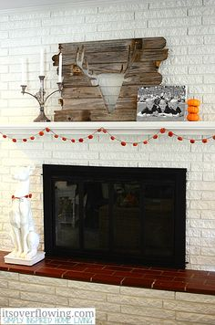 Thanksgiving Mantel Decor Ideas Make A Pom Banner In Fall Colors