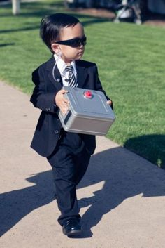 22 Cute And Stylish Ring Bearer Outfits: #21. Security styled ring bearer outfit