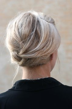 This cute hairstyle requires minimal effort, which makes it perfect for days when you've hit the snooze alarm too many times. Twist one front section of hair back and pin, then gather the lengths of hair at the nape of your neck. Twist the length into itself (like a French twist) then bobby pin up into the bottom of your hair to hide any strays.