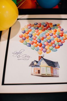 Fans of the movie 'UP' the couple opted for a guest book in the form of a an up-like balloon signed print | Pinwheel Filled Whimsical Red Barn Wedding With Vintage Touches | Photograph by Blest Photography http://storyboardwedding.com/pinwheel-whimsical-red-barn-wedding-vintage/