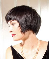 (Not this many layers, more wispy)  *  longer top layers has been heavily razor cut for a wispy shagged result. The bangs have been blunt cut in a straight line above the eyebrows that squares off longer face shapes while drawing attention to the eyes.