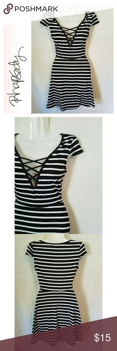 Striped Lace Front Skater Dress Great used condition. Rhapsody brand black and white striped lace front skater dress. Flattering fit. Rhapsody Dresses