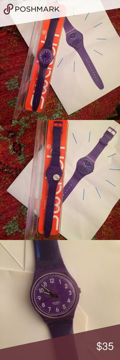 Purple Swatch Watch Gently used purple plastic swatch watch. Face is nice and clear. Band shows very slight wear. Needs new battery (but swatch stores will replace for free!). Also includes original plastic case and warranty. Swatch Accessories Watches