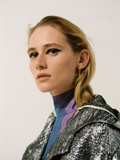 Taffeta turtle neck and metallic coat,  brass earrings Juslin Maunula lookbook photo Osma Harvilahti