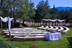 Rustic mountain wedding ceremony with hay bale seating by Take the Cake Event Planning