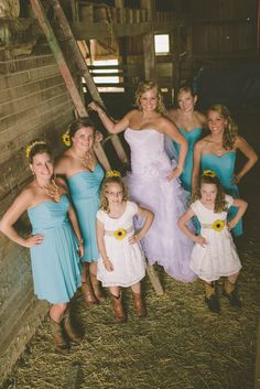 bridal party in boots and malibu blue dresses