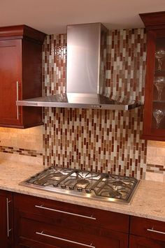 Glass Mosaic Tile Backsplash Behind A Cooktop. Kitchen Remodel By Nealu0027s  Design Remodel. Amazing Pictures