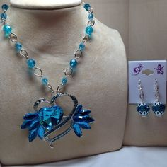 Chunky aqua blue crystal heart pendant with aqua blue acrylic beads and dark blue glass beads strung with silver chain. Adjustable.  PURCHASE: https://admin.shoptab.net/linkbacks/203508649   Handmade Jewelry by Casual Elegant Fashions