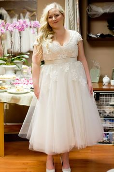 This tea length wedding gown has a belted feature. The cap sleeve help in covering the top portion of the shoulders and arm. Elegant #plussizeweddingdresses like this can be made for you with any change you need to make it your own. (We also can replicate any dress from a picture.) Get pricing and more details on custom plus size wedding dresses at www.dariuscordell.com