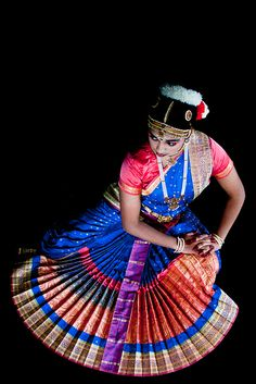 Pre-arangetram photo shoot for a young dancer's professional debut in the Indian classical dance form, Bharatanatyam.