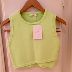 ALC lime green crop top This ALC crop top is brand new never been worn with the tags. The scalloped front is really cute (see photo) and very flattering. So cute for summer and festival season! A.L.C. Tops Crop Tops