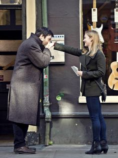 The famous hand kissing moment from The Silkworm Cormoran Strike (Tom Burke) Robin Ellacott (Holliday Grainger)