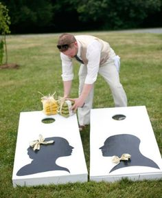 Create personalized cornhole boards with painted silhouettes and let the games begin: