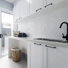 SPLASHBACK A white textured overlay to bring the hamptons to life in the laundry. Also admire the matte black tapware and handles for a a bold yet beautiful contrast. Laundry Room Tile, Laundry Nook, Room Tiles, Small Laundry, Kitchen Tiles, Kitchen Splashback Ideas, Laundry Cabinets, Laundry Baskets, Hamptons Kitchen