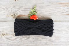 Winter black headband made for 50% wool and 50% acrylic. Soft, warm and very easy. Gentle to the body.    Black winter knitted headband is perfect