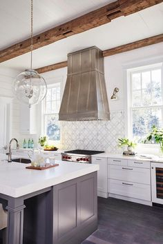 Kitchen tiles go up to hood