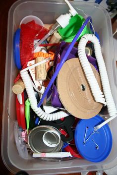 Invention box... Love this!! Random items that the children can play with and try to invent something with!