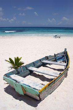 Boat on the Xpu-Ha beach, Mexico.