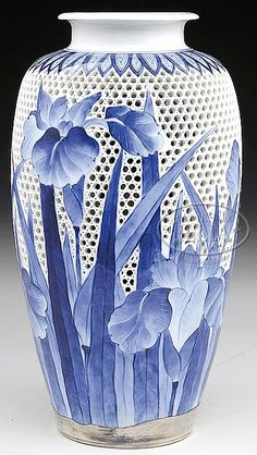 "HIRADO WARE IRIS VASE, SILVER COLLAR. 	Early 20th century, Japan. Double walled type, reticulated basket weave surface decorated with iris flower in underglaze blue, with silver base. SIZE: 12"" h. PROVENANCE: From a private New York State collection."