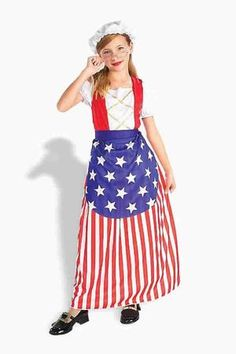 Our Betsy Ross Child Costume is perfect for going out trick-or-treating on Halloween, a school play, or even a theatrical play! This Betsy Ross Child Costume features a white cap headpiece, a red and white striped dress, and star-spangled apron. Additional colonial or patriotic costume accessories (including what is shown) are available and sold separately.