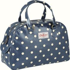 Our new bowling bag is based on a classic vintage design and is roomy enough for all your daily essentials. Finished in our durable oilcloth with an internal zip pocket and two handy side pockets with popper fastenings. This one features our popular Spot print on a petrol blue background.