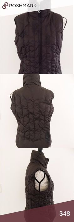 Nine West Medium Gray Puffer Vest Down Blend Nylon shell, polyester lining. Filler is 60% downclusters, 35% waterfowl feathers, and 5% down fibers. Zipper. Used but very good condition Nine West Jackets & Coats Vests