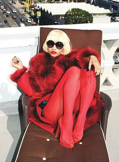 Nicki Minaj in the October 2011 issue of Glamour | Nicki wears a fur-trimmed Vionnet coat, circle Tom Ford sunglasses, Falke tights, and Christian Louboutin peep-toe pumps
