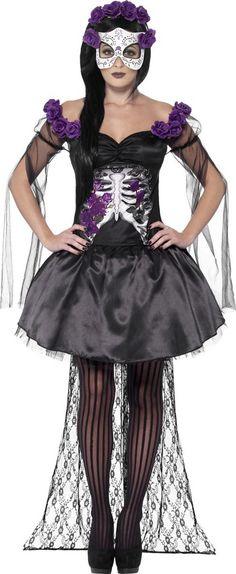 Taille Large Déguisement squelette violet mexicain femme Halloween : Ce déguisement de squelette Mexicain pour femme se compose d'un haut, d'une jupe, d'un serre-tête et d'un masque (collants et chaussures non inclus). Le haut noir est...