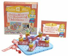 Goldie Blox and The Spinning Machine. An engineering toy marketed to girls. A book series and construction set starring Goldie, the kid inventor.  It builds spatial skills, basic engineering principles, and confidence in problem solving.