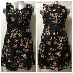 Cute Merona floral dress Cute floral dress with two side pockets, ruffled neckline and tie belt. Worn once - in excellent condition. Merona Dresses