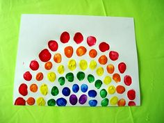 Rainbow Craft For Kids! This simple and colorful Fingerprint Rainbow, would make a cute Turkey Tail for Thanksgiving crafts too! Add a brown handprint for the turkey's body!